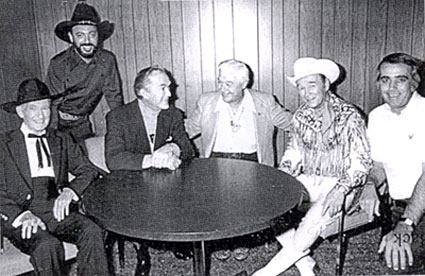 "(L-R) Tim McCoy, record producer and collector Snuff Garrett, Kirk Alyn, Monte Hale, Roy Rogers and Tom Snyder. The group was together for Tom Snyder's NBC late night talk show ""Tomorrow"" on November 28, 1977."