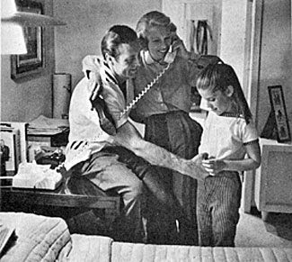 At home in 1957 with George Montgomery, Dinah Shore and their daughter Missy.