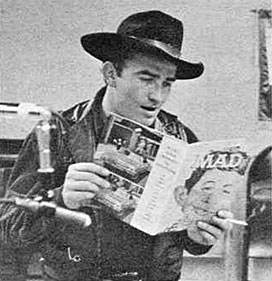 At a horse show in Jackson, MS, the Virginian, James Drury, takes time out to look at MAD Magazine's spoof on his series calling him James Droopy and the Virginiaham.