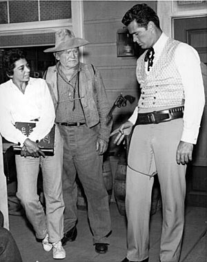 "Warner Bros. scriptwriter Marion Hargrove and longtime character actor Bud Osborne watch James ""Maverick"" Garner practice a gun trick. (Thanx to Terry Cutts.)"