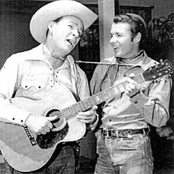"Roy Rogers and Audie Murphy promoting NBC's ""Chevy Show"" (9/27/59), one of 14 color one hour Sunday programs broadcast between '58-'60 that Roy and Dale hosted. During the program, Roy, Audie and Eddy Arnold sang together."