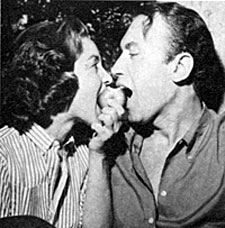 "Michael (""Law of the Plainsman"") Ansara shares an apple with date Beverly Garland."