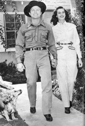 Don and wife Peggy Stewart in 1942. They'd been married about a year. Seen here taking their Spaniel Sir Talleywacker for a walk in front of their San Fernando Valley home.