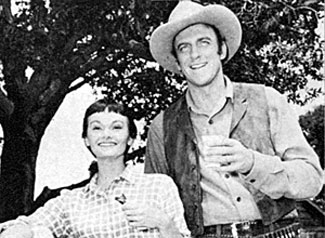 "Guest star Gloria Talbott and James Arness take a break from filming the fourth episode of ""Gunsmoke"", ""Home Surgery"" ('55)."