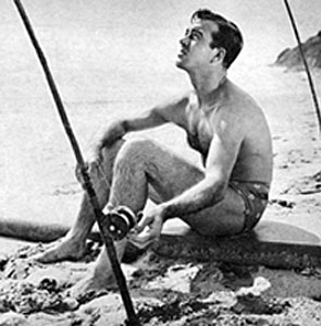 John Payne takes a break from filming to go fishing at Malibu Cove in 1947.