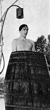 """It's hot out there in the desert making them Hopalong Cassidy movies,"" sez Russell Hayden as he cools off in a makeshift shower."