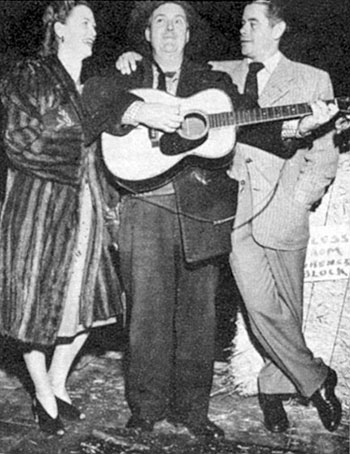 Smiley Burnette seranades Glenn Ford and ?? at the Hitching Post Theater  in the late '40s.