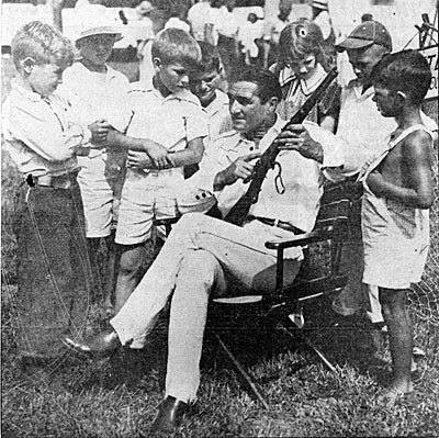 Tom Mix points out a little gun safety to some young fans while his Tom Mix Circus played in Toledo, OH on August 5, 1935.