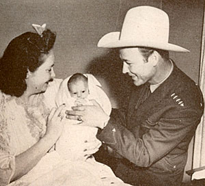Roy and wife Arlene with just born Linda Lou in 1943.