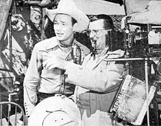"Director Frank McDonald discusses with Roy the next scene for ""Along the Navajo Trail"" ('45 Republic)."