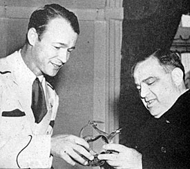 Roy presents a pair of silver spurs to Mayor Fiorello LaGuardia during a New York visit.