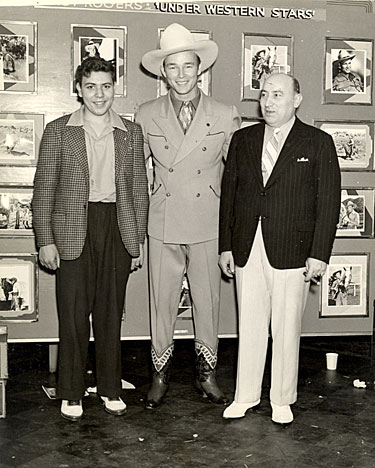 "Roy Rogers with Herbert J. Yates and an unidentified young boy...perhaps a contest winner? ""Under Western Stars"" ('38)."