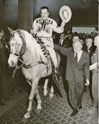 "Leo Carrillo, TV's Pancho on ""The Cisco Kid"", and his horse Conquistador ride into the foyer of the Sherman-Ambassador hotel in Chicago on December 5, 1957, for the 45th Annual Convention of the Showman's League of America. Beside Carrillo is hotel board chairman Frank W. Bering, a livelong friend of Leo's."
