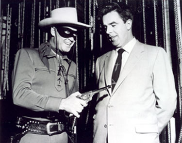 Clayton Moore as the Lone Ranger at a public appearance in Kansas City with local dignitary Matt Plunkett (2/11/56).