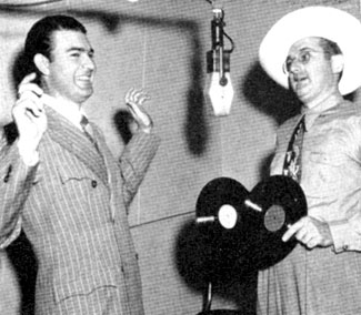 RCA Victor gag photo as band leader Tommy Dorsey holds up Tex Williams with two records instead of two guns (11/48).