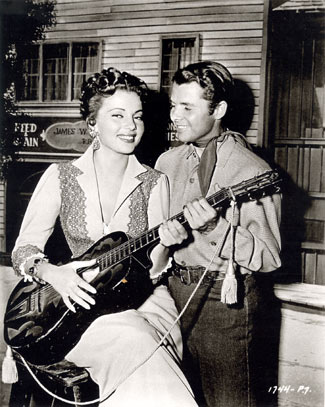 "Band singer Abbe Lane and Audie Murphy between takes on ""Ride Clear of Diablo"" ('53 Universal-International)."