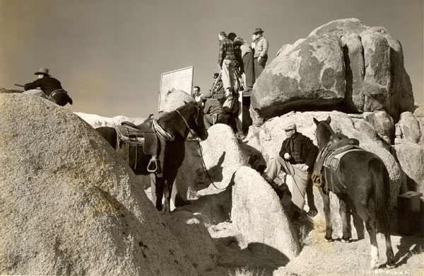 "Amidst the Alabama Hills of Lone Pine, an RKO crew prepares to film a scene with badman Harry Woods atop the rocks on the left for James Warren's ""Sunset Pass"" ('46)."