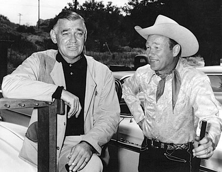Roy Rogers and Clark Gable when Roy purchased Gable's Pigeon grade Model 12 shotgun. Story is, Gable was having a bad day at the trap field, so as he came off the field he held up the shotgun and begged someone to make an offer for the SOB shotgun. Roy quickly responded and bought the gun for $600. He promptly went out and shot 50 clays in a row and from that day on he didn't bother with another shotgun.