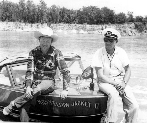 Down in Texas, Roy Rogers sits on his speedboat, Miss Yellow Jacket II. Roy was a part owner for awhile of the company which was in operation from 1949-1959.