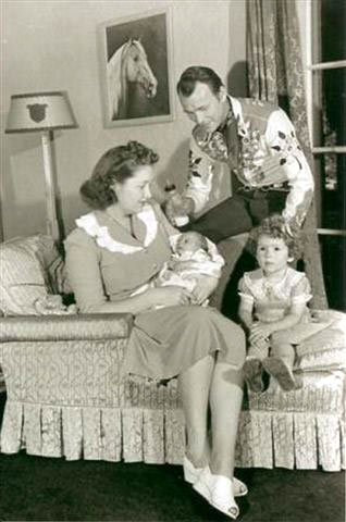 Roy and wife Arline at home with nine week old Linda Lou and 3 year old Cheryl. Note the painting of Trigger (or is it Little Trigger?) on the wall done by famous Danish western painter Olaf Wieghorst. It was painted by Wieghorst before he became famous. He'd been a policeman in New York City which is where Roy met the artist during one of his early Madison Square Garden appearances. The painting was sold after Roy and Dale's deaths at a High Noon auction in Mesa, Arizona for $25,000. (Thanks to Bobby Copeland, Mike Johnson, Leo Pando.)