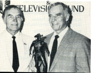 George Montgomery (left) presents Charleton Heston with the 1992 Hollywood Westerner Hall of Fame President Reagan Award. The bronze, created by George, recognizes actors for lifetime achievement in westerns.