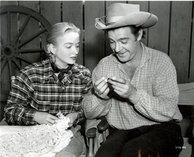 "Definite incongruity here as Lon Chaney Jr. shows Jeanne Kelly the intricacies of tatting (a technique for handcrafting a particularly durable lace constructed by a series of knots and loops) between scenes for the Universal serial ""Riders of Death Valley"" ('41)."