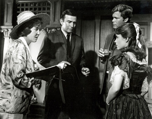 "Director Ida Lupino has a script conference with ""The Virginian"" stars James Drury and Doug McClure along with guest star Alice Rawlings for the ""Dead Eye Dick"" episode of June '66."