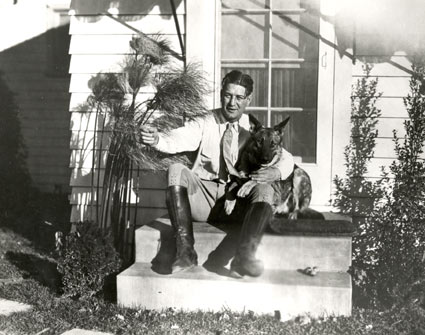 One of the top silent screen cowboys, Art Acord, at home with his dog. Circa late '20s.