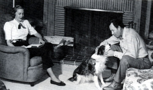 Bill Elliott at his Malibu Colony beach home in 1947 with his wife Helen and dog Sister.