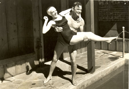 "Buck Jones has a little poolside fun with leading lady Ruth Coleman between takes of ""Headin'East"" ('37)."