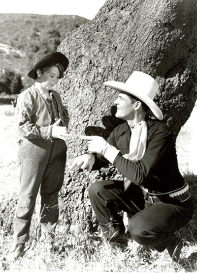 "Charles Starrett and Delmar Watson discuss their scenes in an offscreen moment from ""Outlaws of the Prairie"" ('37 Columbia). This Starrett film contains the most bloodthirsty, brutal scene in B-western history. Excruciating to watch, it's amazing the scene made it past the censors. Two outlaws (Lambert Rogers, Dick Alexander) shoot and kill Starrett's father while he watches as a young boy (Delmar Watson). He wings one of them in the arm with his rifle, then Rogers viciously cuts two fingers off the boy's right hand with a hunting knife while the boy screams in pain. Rogers literally adds insult to injury and kicks the devastated boy leaving him crying and screaming in pain. Full grown, now a Texas Ranger, Starrett searches the West for the killer and eventually finds him."