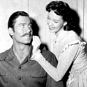 "Clint Walker and Sally Fraser clown around on the set of ""Cheyenne: The Trap"" ('56)."