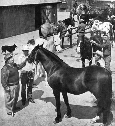 "A rare photo of Clarence ""Fat"" Jones (left) at his Hollywood horse stables on Sherman Way in North Hollywood. Jones founded the stable originally in Edendale (now Silverlake) in 1912 and rented horses to movie companies for 51 years. (Photo courtesy Kenneth Kitchen.)"