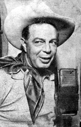 Hoot Gibson steps before a microphone in the mid '40s.