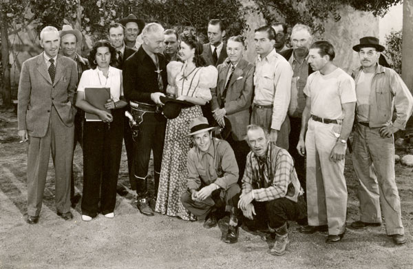 "Partial cast and crew for the Hopalong Cassidy western ""Bar 20"" ('43). That's Hoppy with leading lady Dustine Farnum (daughter of Dustin Farnum) and of course Andy Clyde kneeling in front. Rest of the group is unidentified. Can anyone help with any IDs?"