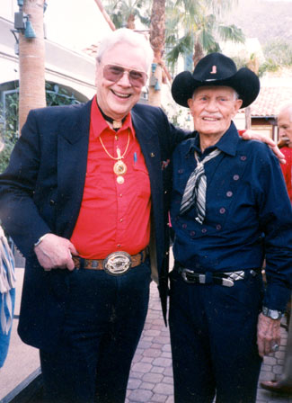 Monte Hale and badman Pierce Lyden pose for a moment at a Palm Springs event.