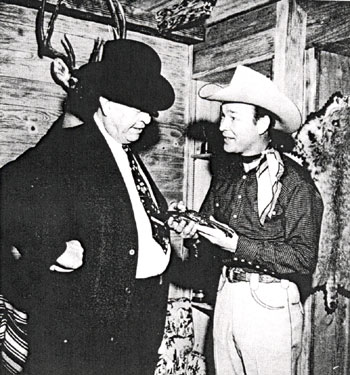 Legendary Captain Frank Hamer of the Texas Rangers and Roy Rogers examine a pistol at Roy's home. Hamer and others ambushed the notorious Bonnie and Clyde near Gibsland, LA, on May 23, 1934.