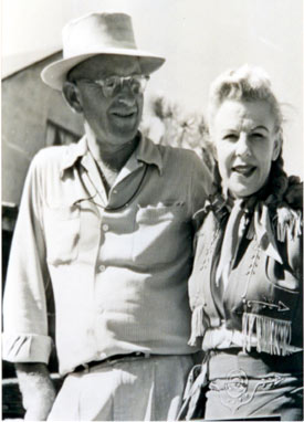"Alice Van (Springsteen), ready to double Gail Davis as ""Annie Oakley"", paused to take a photo with noted cinematographer Bill Bradford, who worked tirelessly for Gene Autry's Flying A Productions. Alice was married to noted director R. G. Springsteen."