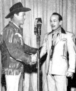 Roy Rogers congratulates Spade Cooley on his new television show originating from the Santa Monica Ballroom in California in 1948.