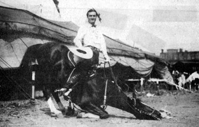 Tom Mix and Tony perform one of their numerous tricks on the grounds of Tom's circus.