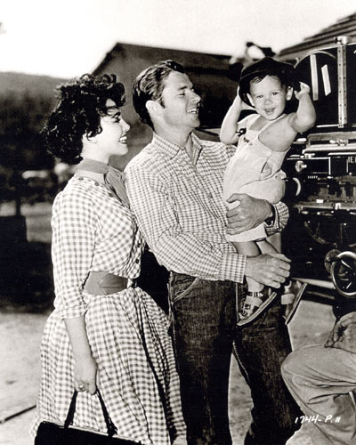 "Seventeen month old Terry Murphy is the guest of his Dad Audie Murphy and co-star Susan Cabot on the set of ""Ride Clear of Diablo"" ('53 Universal-International)."