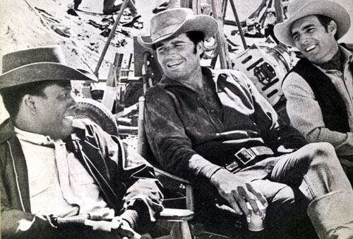 "Sidney Poitier, James Garner and Dennis Weaver relax between scenes of ""Duel at Diablo"" ('66)."