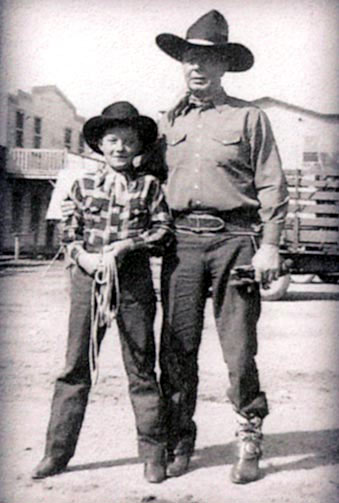 "Eleven year old Don Stewart with Hoot Gibson on the back lot while making the Trail Blazers' ""Wild Horse Stampede"" ('43 Monogram). Don, born Dec. 23, 1931, in Tulsa, Oklahoma, moved with his family to California as a youngster. He attended William S. Hart High School and graduated from Glendale College with a degree in art. After his three films (""Wild Horse Stampede"", ""Arizona Whirlwind"" with the Trail Blazers in '44 and ""Where Trails End"" in '43 with Tom Keene) Don became a successful artist and owned a flower and gift shop in Newhall, CA, where he was well known for his art and unusual floral designs. Don fought in the Korean War and later died at 49 in Corpus Christi, TX, while on a hunting trip with friends. According to Don's sister-in-law, Barbara Stewart of Modesto, CA, ""Don went down in the yacht to have a nap between trips to the islands and simply didn't wake up."" As a bit of trivia, as a child, Don's brother Joe (12 years younger than Don) was on June Lockhart and Eleanor Powell's ""Faith of Our Children"" on NBC ('53-'55) produced by Glenn Ford."
