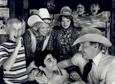 "Low budget B-western star Johnny Carpenter at his Heaven On Earth Ranch which benefitted handicapped children. Photo was taken for ""Hour Magazine"" TV series for September 26, 1980. Co-host Pat Mitchell in the white hat."
