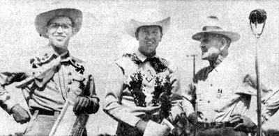 Rex Allen at the Dodge City, KS, Boot Hill Fiesta Rodeo in May 1952. On his left is Harry G. Wiles, state president of the Junior Chamber of Commerce. On his right is Sheriff Claude Dowdy.