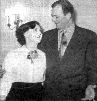 Jacqui McKenzie, a senior secretary at Republic Pictures Corporation in London, England, poses in the late '40s with John Wayne. (Thanx to Terry Cutts.)