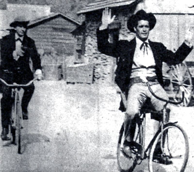 "The caption to this news photo was ""Bret's Bart is worse than his bike.""Jack Kelly and ""Maverick"" brother James Garner clowning around between scenes on the Warner Bros. backlot."