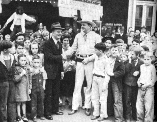 "PRC's ""Cowboy Rambler"" Bill Boyd meets with a group of his fans in 1942."
