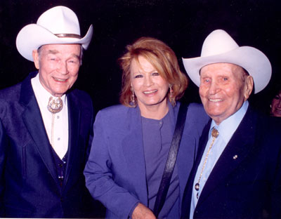 Roy Rogers, Angie Dickinson and Gene Autry at a Golden Boot Awards dinner in the '90s. (Photo courtesy Neil Summers.)