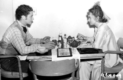 A young pre-war Tim Holt lunches with actress Ann Shirley in the RKO commissary.